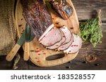 Freshly smoked ham in homemade smokehouse - stock photo
