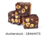 Chocolate fudge brownies with hazelnuts, isolated on white. - stock photo