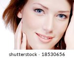 portrait of close-up  young adult  woman face with the smile - stock photo