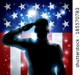 Patriotic soldier or veteran saluting in front of an American flag background  - stock photo