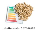 wooden pellets and energy efficiency levels on white background - stock photo