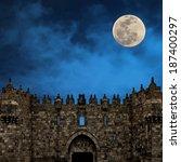 Moonrise over the Damascus Gate  -  the Old city of Jerusalem (Israel) - stock photo