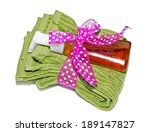 A set of hand or dish towels with liquid soap tied up as a gift. - stock photo