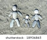 pebble family on a sand - stock photo