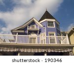 This is a shot of a purple colored victorian style home in Ocean Grove, NJ. - stock photo