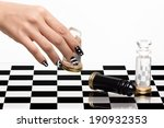 Beautiful woman hand with luxury nails in black and white playing chess. Manicure and nail art. Closeup portrait isolated on white - stock photo