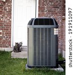 Air-conditioner and two cats on backyard - stock photo