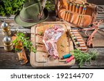 Venison on table of the hunter in forester lodge - stock photo