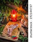 Venison prepared for roasting in hunter lodge - stock photo