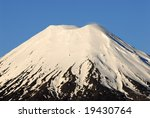 Mt Tongariro - a snow capped volcano in New Zealand's North Island at sunset - stock photo