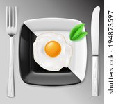 Served breakfast. Fried egg on black and white plate served with fork and knife - stock vector