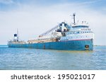 Cleveland, Ohio - May 26: The 71 year old Great Lakes freighter Manistee enters the Port of Cleveland, Ohio on May 26, 2014 with a load of iron ore for a local steel mill. - stock photo