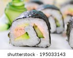 japanese maki sushi rolls with salmon,cucumber and fresh avocado - stock photo