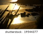 Sunset on a New Zealand beach in the township of Riverton in the South Island - stock photo