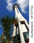 low angle view of auckland's iconic skytower with brilliant blue sky in the background - stock photo