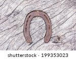 Wooden table top with a horseshoe decor - stock photo