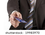 Businessman handing over credit card (number and card are fictitious) - stock photo