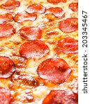 Appetizing background pepperoni pizza closeup filling the frame. - stock photo