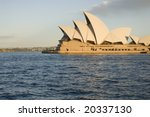 SYDNEY, November 11, 2008 - Late afternoon summer shot featuring horizontal side view of Sydney Opera House with harbour in foreground. Photographed in Sydney, Australia on 11 November, 2008. - stock photo