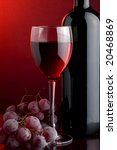 a glass of red wine a bottle and grape - stock photo