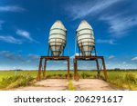 Two Fertilizer Silos in a Green Summer Field in The Netherlands - stock photo