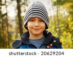 Portrait of a beautiful boy on a sunny autumn day - stock photo