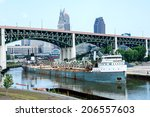 CLEVELAND, USA - JULY 22: Launched as the Adirondack in 1943, the 71 year old Manistee prepares to offload aggregate materials onto the bank of the Cuyahoga River at Cleveland, Ohio on July 22, 2014. - stock photo