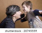 Boy giving his grandmother a huge hug - stock photo