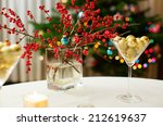 Decorated christmas dining table with champagne glasses and christmas tree in background - stock photo