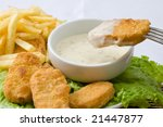 fried chicken nuggets with sauce for dipping and fries - stock photo