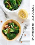 Diet meal - Broccoli, almonds, bacon with lemon - stock photo