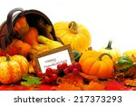 Harvest basket with spilling autumn vegetables and Happy Thanksgiving tag - stock photo