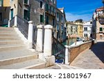 White bridge over blue water of a venetian canal, Italy - stock photo