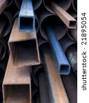 Stack of rusty steel pipes. Shallow DOF. - stock photo
