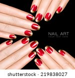 Holiday Nail Art. Luxury nail polish with golden glitter French manicure. Manicure and nail art concept. Closeup hands isolated on black with sample text - stock photo