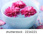 flowers in blue bowl with water - stock photo