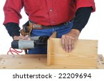 Woodworker using a Nail Gun - isolated over white - stock photo