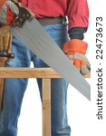 Construction Worker Cutting Beam with hand saw isolated over white - stock photo