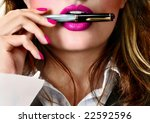 Sexy young pretty woman / model / girl / student / businesswoman / secretary with pink lips, vintage / retro is holding a pen in her lips / seductive - closeup - stock photo