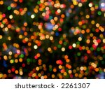 An abstract holiday background of colorful Christmas lights. - stock photo
