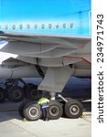 Airplane parked at the airport and preparation for next flight - stock photo
