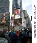 TIMES SQUARE, NEW YORK CITY, JANUARY 20, 2009: Big crowds observe history in Times Square, NY as Barack Obama is inaugurated as the 44th President of the United States. - stock photo
