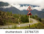 Long road with signs on its sides - stock photo
