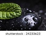 black stone whit leaf of mint and drops - stock photo