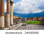 Ancient columns ruins after the eruption of Vesuvius in Pompeii, Italy - stock photo