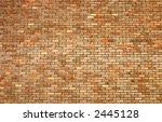 Large multicolored brick wall - stock photo