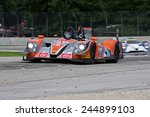 Elkhart Lake Wisconsin, USA - August 18, 2012: Road America Road Race Showcase, ALMS sports car motor race. American Le Mans Series. Martin Plowman, David Heinemeier Hansson, Morgan LMP2  - stock photo