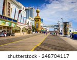 ATLANTIC CITY, NEW JERSEY - SEPTEMBER 9, 2012: Tourists walk on the boardwalk in Atlantic City. - stock photo