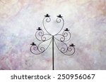 vintage candlestick with grunge wall - stock photo