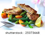 Delicious Weiner Schnitzel, with asparagus, green beans, and orange cherry tomatoes. - stock photo